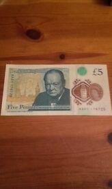 New £5 serial number AA01