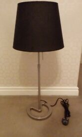 Nickel plated table lamp with mood lighting control and black shade.