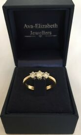 18ct yellow gold .50ct diamond trilogy ring.