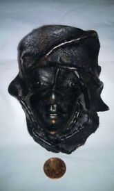 leather mask wall hanging