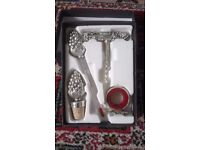 4 piece boxed wine lovers gift set, unmarked heavy white metal.
