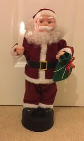 Light up, Moving, Musical Santa Claus Decoration