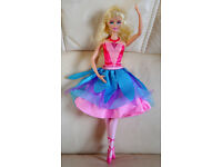 Ballerina Barbie in the pink shoes with two outfits by twisting her torso