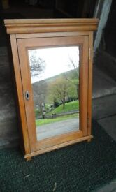 Pine cabinet with mirror on front