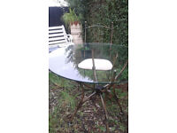 Glass and iron round 92 cm dining table and two metal chairs