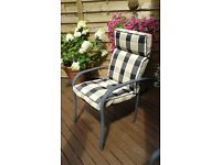 4 metal framed garden chairs with cushions.