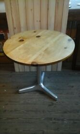Pine table with alloy base. 4 available