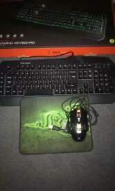 Black Web Gaming Keyboard and Mouse with mat