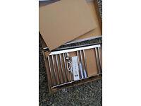Small heated towel rail. New still in box.