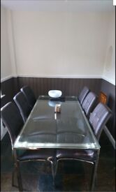 Dining table and 6 brown chairs