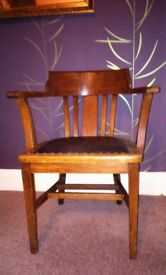 a vintage old docs look chair for restore .wood and leather look alike