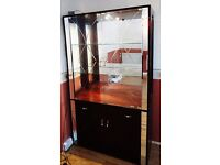 Large display cabinet with glass doors