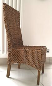 high back grass dining chairs with mango wood legs. 4 available