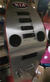Ex car stereo display stand comes with stereos and speakers great for man cave etc