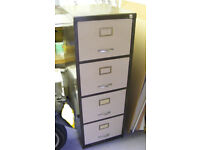 Four-drawer steel filing cabinet in good condition