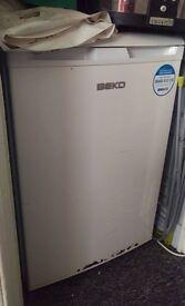 Under counter Beko fridge with freezer compartment