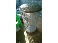 Grey round laundry basket