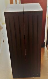 A folding media cabinet in a brown satin finish with all shelves intact and in excellent condition.