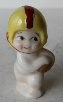 - Football Player Figurine Baby w- Yellow Helmet Ceramic-Porcelain Hand Painted