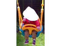 Little tikes wooden swing.....Also comes with a seat for an older child.