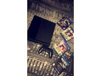 PS4, comes with 4 games and a controller
