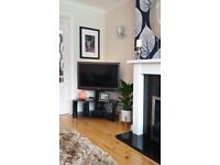 Iconic black glass corner cantilever stand for TVs up to 52 inch