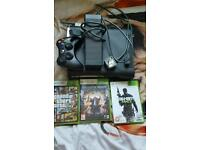 XBOX console with 3 games