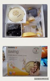Madela breast pump and extras