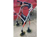 Walking frame with seat, wheels and brakes