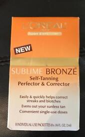 1 BOX OF 8 SINGLE USE DOSES OF --  L`OREAL SUBLIME BRONZE SELF TANNING PERFECTOR & CORRECTOR.