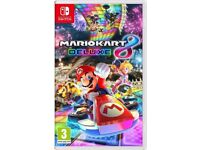 **SEALED** NINTENDO SWITCH AND MARIO KART DELUXE 8 GAME BRAND NEW AND INCLUDES 1 YEAR WARRANTY