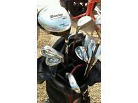 Golf clubs and Dunlop bag