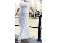 Wedding dress.Used once.Size 12/14.Great condition.