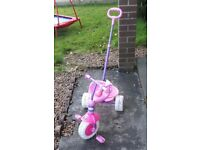 Kid's tricycle with push bar