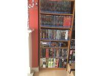 Large light brown bookshelf