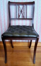 4 Dining chairs dark wood buttoned seats in very dark green - almost black. Good condition