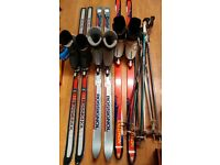 3 PAIRS OF SKIIS, BOOTS AND POLES.
