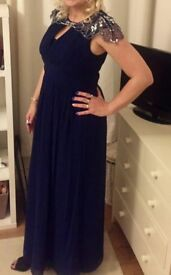 Blue evening dress with sequence shoulders