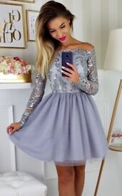 Stunning silver, long sleeve dress, ideal for every occasion