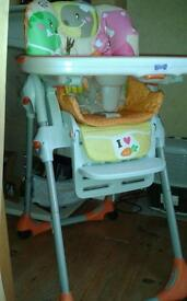 Chicco baby high chair with removable tray.