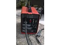 MIG WELDER AS PICTURED WITH MASK, WIRE, SPARE TIPS AND SHROUD.