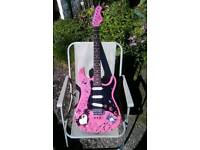 Guitar for girl who wants to rock comes with ten watt kustom amp and case