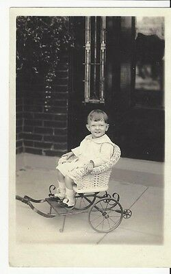 Vintage Photo Small Child on Wicker Chair on Wheels ()