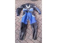 Blue and black all in one bike leathers