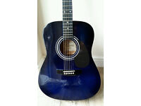 Blue Encore acoustic guitar in gig bag.