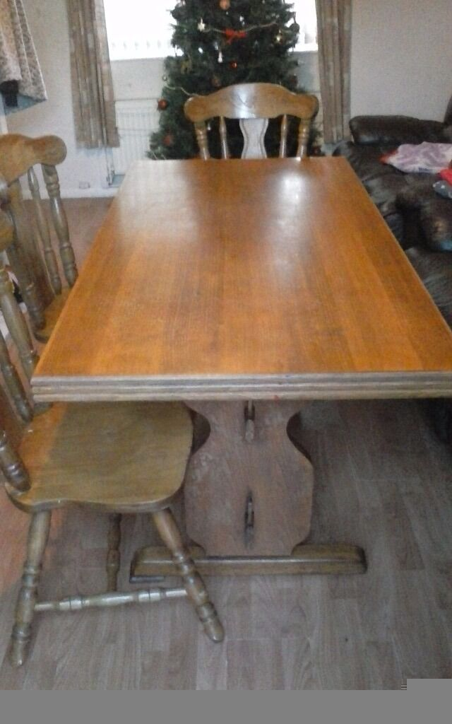Table and three chairs in used but good condition