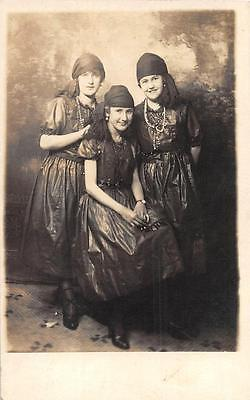 RPPC HALLOWEEN THREE YOUNG WOMEN IN COSTUME STUDIO REAL PHOTO POSTCARD (c. 1910) (Studio C Halloween)