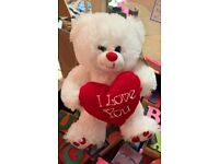 "Brand new teddy bear with ""I love you "" heart."