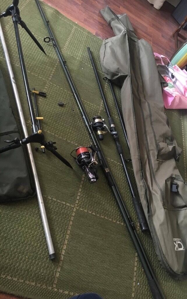 Two carp rods an reals in a rod bag bits of tackle an bite alarm