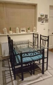 Glass top wrought iron effect dining table